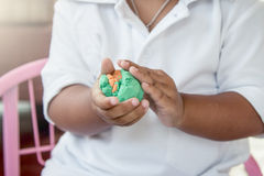 Child hand playing with clay Stock Image