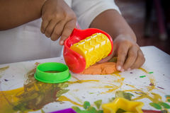Child hand playing with clay Royalty Free Stock Image
