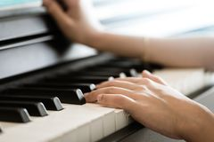 Hand playing Music keyboard electric piano. Child Hand playing Music keyboard electric piano stock photos