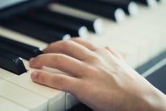 Child Hand playing Music keyboard piano. Child Hand playing Music keyboard electric piano stock image