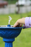 Child hand playing in water. A child hands playing in a small water pool Royalty Free Stock Photos