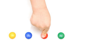 Child hand pressing on red button Royalty Free Stock Photos