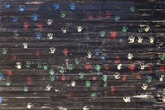 Child hand prints. On black wall Stock Photography