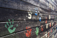 Child hand prints. On black wall Stock Photos