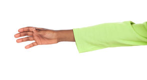 Child hand reaching. Small african child's hand reaching out. Image is isolated on a white background stock photography
