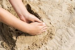 Child hand on a sand Royalty Free Stock Photo