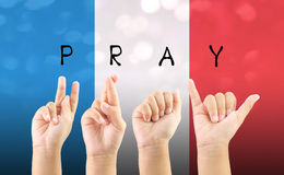 Child hand sign language alphabet pray for Paris with clipping. Path royalty free stock photography