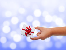 Child hand with small present Stock Photography