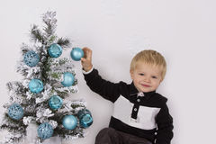 Child hand touching Christmas ornament Stock Photography
