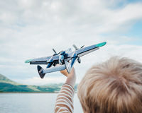 Child hand with toy plane Stock Image
