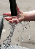 Child hand in water stock images