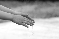 child hand with waterdrop Stock Photography