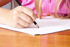 Child hand writing Royalty Free Stock Image
