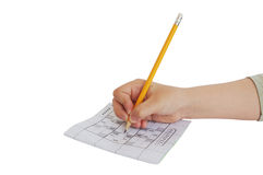 Child hand writing on sudoku game Stock Image