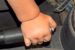 Child and handbrake Stock Photo