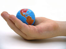 Child handing a globe. Child handing a globe with one hand close-up and white background stock images