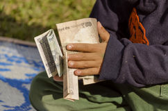 Child handling lots of money Royalty Free Stock Photography
