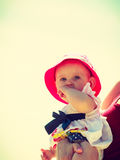 Child in hands of adult on summertime Royalty Free Stock Image