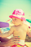 Child in hands of adult on summertime Royalty Free Stock Photos