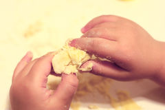 Child hands baking dough Royalty Free Stock Image