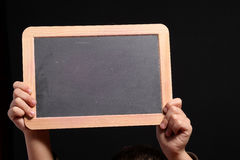 Child hands and blackboard royalty free stock images