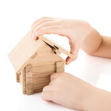 Child hands build a house Stock Photo