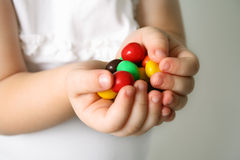 Child the hands the candies royalty free stock photography