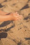 Child hands closeup. from hand pours sand lifestyle contact pedigree ancestry.  royalty free stock photography