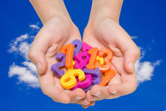 Child hands with color numbers. Royalty Free Stock Photography
