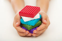 Child hands with colorful clay blocks Stock Image