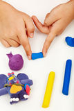 Child hands with colorful clay Royalty Free Stock Images