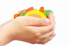 Child hands with colorful fruity sweets closeup Stock Photo