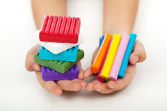 Child hands with colorful modeling clay Stock Images