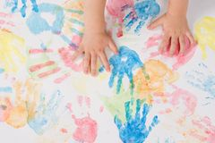 Child hands colorful painting Stock Photo