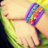 Child hands with Colorful rubber rainbow loom band bracelets Royalty Free Stock Images