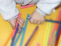 Child hands and crayons Stock Photos