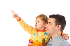 Child on hands at daddy points finger Royalty Free Stock Photos
