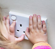 Child Hands on electrical sockets Royalty Free Stock Images