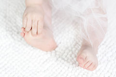 Child hands and foot. White child hands and foot Royalty Free Stock Image