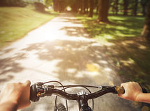 Child hands on the handlebar close up image Stock Photo