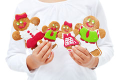 Child hands with happy gingerbread people family Royalty Free Stock Images