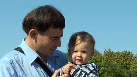 A child at the hands of his father stock footage