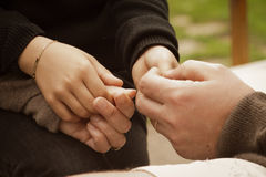 Child hands in his parents hands. The arm of the child holds a bracelet Royalty Free Stock Image