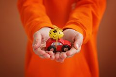 Free Child Hands Holding Easter Egg On Car On Orange Background. Holiday Concept Royalty Free Stock Image - 112693636