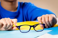 Child hands holding eye glasses.  Royalty Free Stock Photography