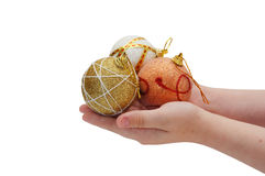 child hands holding three christmas balls Stock Photos
