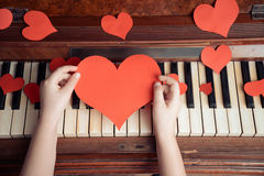 Child hands holds paper heart Royalty Free Stock Photo