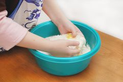 Child hands kneading a dough Royalty Free Stock Photography