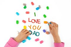 Child hands made the words I love You Dad. stock photo