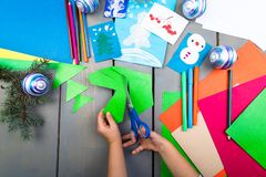 Child hands make handmade christmas toys from cardboard. Children's DIY concept. Child hands make handmade christmas toys from cardboard. Children's DIY concept royalty free stock image